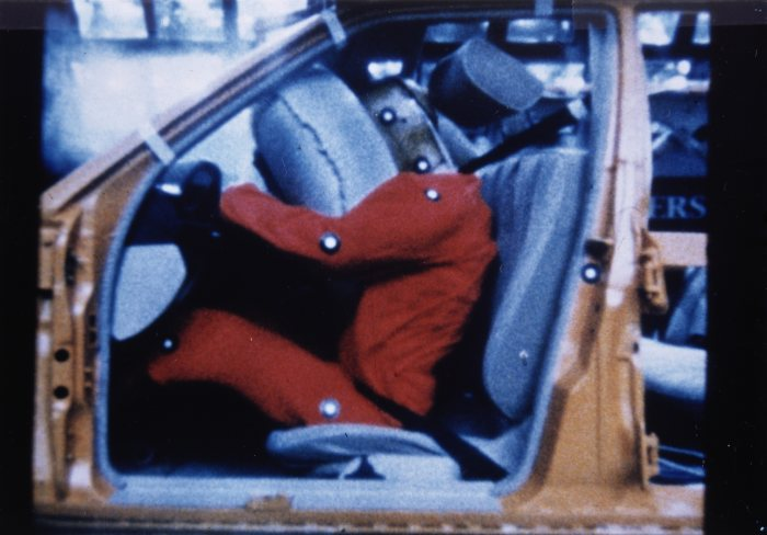 Sequence showing the functioning of steering-wheel airbag and belt tensioner, 1981. At that time, Daimler-Benz was the world's only manufacturer to offer the belt tensioner for the front passenger and the airbag for the driver.