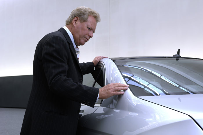 Professor Peter Pfeiffer, Senior Vice President Design Mercedes-Benz, checks the 1:1 model of the new C-Class.