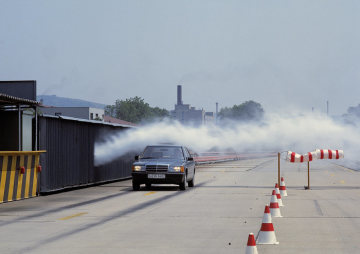 A Mercedes-Benz 201-series Saloon undergoes crosswind testing on the test track at the Untertürkheim plant.