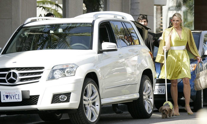 "Actress Kim Cattrall in the background of the new Mercedes-Benz GLK. Scene for the upcoming feature movie ""Sex and the City"" in Beverly Hills California on Sunday, Dec. 16, 2007."