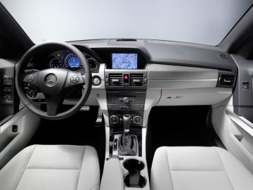 Mercedes-Benz GLK-Class: The interior sports package includes a leather-lined 3-spoke steering wheel with gearshift paddles and aluminium trim elements in the dashboard and door panels. Standard equipment for all model variants includes the controller in the centre console for operation of the audio system or the COMAND infotainment system with its fixed display.