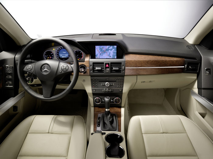 "Mercedes-Benz GLK-Class: The well-equipped and comfortable interior impresses with its high quality of materials and precise attention to detail – the luxurious interior atmosphere typical of a Mercedes. On request the interior can be further enhanced with leather upholstery or wood trim elements in ""brown pine"" or ""burr walnut""."