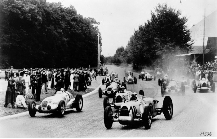 Swiss Grand Prix, Bremgarten, August 22, 1937. Rudolf Caracciola, who was to win the race, with start number 14 in a Mercedes-Benz W 125.  In the fore: Bernd Rosenmeyer (start number 8) and Hans Stuck (start number 10), both in Auto Union.