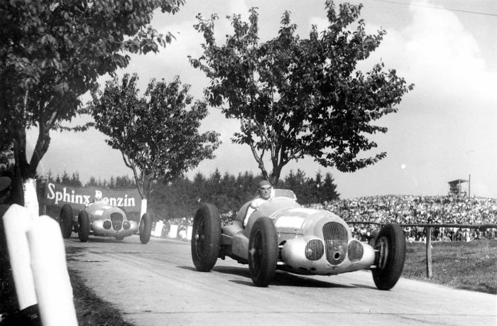 Manfred von Brauchitsch ahead of Richard Seaman at the Masaryk Grand Prix in Brno. They finished in 2nd and 4th respectively, with Rudolf Caracciola winning the race. All driving the Mercedes-Benz W 125 750 kilogram racing car..