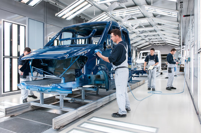 The Mercedes-Benz plant in Ludwigsfelde is one of the biggest employers in Brandenburg. Employees in the Paint Finish section check the surface of a Mercedes-Benz Sprinter.