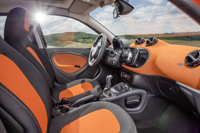 The new smart forfour 2014: Upholstery in black / orange fabric, Dashboard and door centre panels in orange fabric and contrast components in black/grey