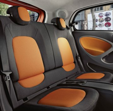 The new smart forfour, 2014: Rear seats Upholstery in black / orange fabric, Dashboard and door centre panels in orange fabric and contrast components in black/grey