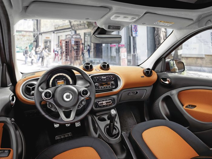 The new smart forfour, 2014: Upholstery in black / orange fabric, Dashboard and door centre panels in orange fabric and contrast components in black/grey