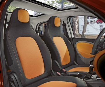 The new smart forfour, 2014: Front seats Upholstery in black / orange fabric, Dashboard and door centre panels in orange fabric and contrast components in black/grey
