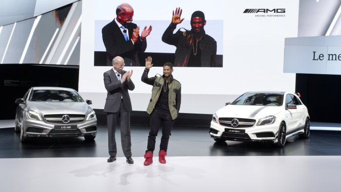 Mercedes-Benz at the Geneva Motor Show 2013: Dr. Dieter Zetsche, Chairman of the Board of Management of Daimler AG and Head of Mercedes-Benz Cars, and the world-famous American pop singer Usher at the A45 AMG world premiere in Geneva.