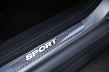 "Mercedes-Benz Accessories for the CLA: Mercedes-Benz Sport Equipment - illuminated door sill panels made of stainless steel, featuring ""Sport"" lettering which lights up when getting in and out of the vehicle."