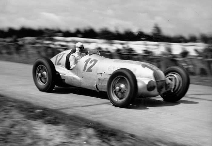 1937 German Grand Prix, the eventual winner Rudolf Caracciola in the Mercedes-Benz W 125.
