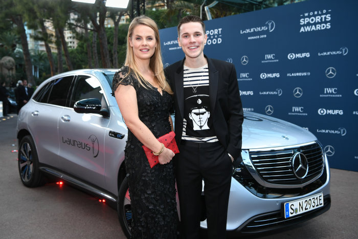 Felix Jaehn (DJ, r.) together with Bettina Fetzer (Vice President Marketing Mercedes-Benz Cars) in front of a Mercedes-Benz EQC 400 4MATIC. GES/ Sport: Laureus World Sports Awards 2019, February 18, 2019