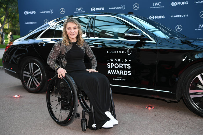 Kristina Vogel (former track cyclist) in front of a Mercedes-Benz car. GES/Sport: Laureus World Sports Awards 2019, February 18, 2019
