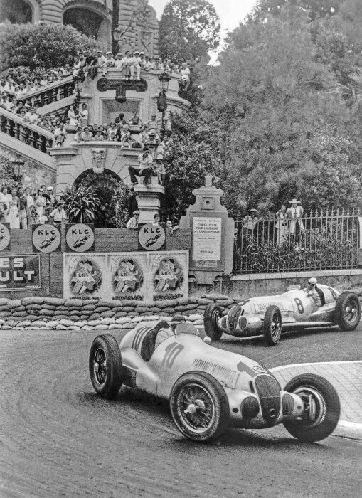 Monaco Grand Prix, August 8, 1937: Winner Manfred von Brauchitsch and runner-up Rudolf Caracciola in the Loews corner, both of them driving Mercedes-Benz W 125 formula racing cars.
