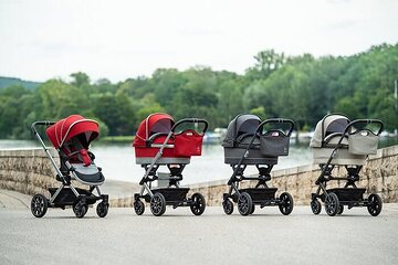 "Mercedes-Benz Baby Carriage Avantgarde from Hartan: ""Dolce Vita"" Infant Carrier Bag in beige / brown with Undercarriage in Arensica; ""DESSIN Sport"" Infant Carrier in black / anthracite / silver with Undercarriage in iridium silver;  ""Hyacinth red"" design with ""Hightec silver"" undercarriage; all models come with AMG inspired 5-twin-spoke wheel design, air-chambered tyres and adjustable suspension."