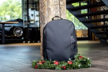 Rucksack, coated, black, polyurethane/ polyester, main compartment with 2-way zip and various inner compartments such as laptop compartment, pockets or pen holder.